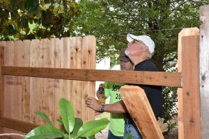 Volunteers from ServeINC putting in a new fence.